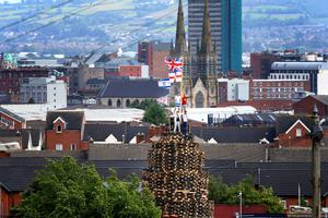 One of the huge bonfires that towers over the houses and looks over the city of Belfast in preparation for the 11th of July celebrations when the bonfires are lit in many Protestant, unionist and loyalist areas of Northern Ireland. Photo: William Cherry / Presseye