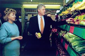 Bill Clinton. US President's visit to N.I. 1995.  President Clinton visits Violet Clarke's fruit shop on the Shankill Road, Belfast.  1/12/1995  THE PRESIDENT CLINTON MAKES HIS SELECTION.