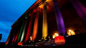 Pillars of St Georges Hall, Liverpool, have the colours of of a rainbow flag projected onto them following a vigil for the victims of the Orlando Shootings at a Gay nightclub in Florida. Peter Byrne/PA Wire