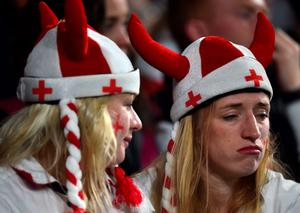 England fans react  during a Pool A match of the 2015 Rugby World Cup between England and Australia at Twickenham stadium, south west London, on October 3, 2015.  AFP PHOTO / BEN STANSALL  RESTRICTED TO EDITORIAL USE, NO USE IN LIVE MATCH TRACKING SERVICES, TO BE USED AS NON-SEQUENTIAL STILLSBEN STANSALL/AFP/Getty Images