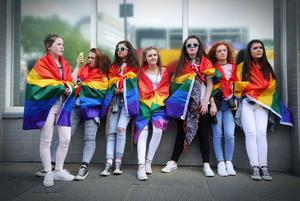 Press Eye - Belfast - Northern Ireland - 1st August 2015 -   Teenagers look on as thousands of people take part in the annual Belfast Gay Pride event in Belfast city centre celebrating Northern Ireland?s LGBT community.  Organisers claim there was a larger than normal turnout in the wake of the recent same-sex marriage referendum in the Republic of Ireland.  Picture by Kelvin Boyes / Press Eye.