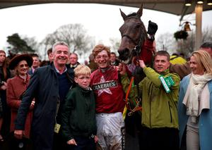 Owner Michael O'Leary (left) and jockey David Mullins celebrates with Rule The World after winning the Crabbie's Grand National Chase during Grand National Day of the Crabbie's Grand National Festival at Aintree Racecourse, Liverpool. PRESS ASSOCIATION Photo. Picture date: Saturday April 9, 2016. See PA story RACING National. Photo credit should read: David Davies/PA Wire