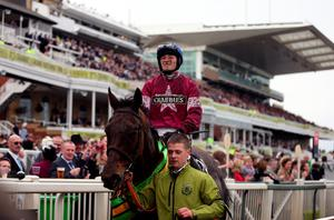 Jockey David Mullins on Rule The World after winning the Crabbie's Grand National Chase during Grand National Day of the Crabbie's Grand National Festival at Aintree Racecourse, Liverpool. PRESS ASSOCIATION Photo. Picture date: Saturday April 9, 2016. See PA story RACING National. Photo credit should read: David Davies/PA Wire