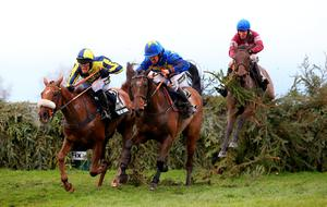 (From left to right) The Last Samuri ridden by David Bass,  Vics Canvas ridden by Robert Dunne and Rule the World ridden by David Mullins lead the Crabbie's Grand National Chase during Grand National Day of the Crabbie's Grand National Festival at Aintree Racecourse, Liverpool. PRESS ASSOCIATION Photo. Picture date: Saturday April 9, 2016. See PA story RACING National. Photo credit should read: Mike Egerton/PA Wire