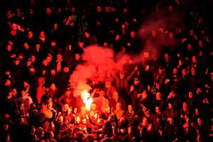 DORTMUND, GERMANY - APRIL 07:  Borussia Dortmund fans light a flare during the UEFA Europa League quarter final first leg match between Borussia Dortmund and Liverpool at Signal Iduna Park on April 7, 2016 in Dortmund, Germany.  (Photo by Stuart Franklin/Bongarts/Getty Images)