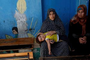 Palestinian women rest at the Abu Hussein U.N. school, in the Jebaliya refugee camp, northern Gaza Strip, Wednesday, July 30, 2014.  (AP Photo/Hatem Moussa)