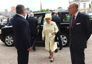 Queen Elizabeth II and Prince Philip, Duke of Edinburgh arrive at Hillsborough Castle before attending a Garden Party on June 24, 2014 in Belfast, Northern Ireland. (Photo M T Hurson /Harrison Photography via Getty Images)