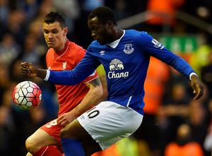 Liverpool's Croatian defender Dejan Lovren (L) vies with Everton's Belgian striker Romelu Lukaku during the English Premier League football match between Liverpool and Everton at Anfield in Liverpool, north west England on April 20, 2016. / AFP PHOTO / PAUL ELLIS / RESTRICTED TO EDITORIAL USE. No use with unauthorized audio, video, data, fixture lists, club/league logos or 'live' services. Online in-match use limited to 75 images, no video emulation. No use in betting, games or single club/league/player publications.  / PAUL ELLIS/AFP/Getty Images