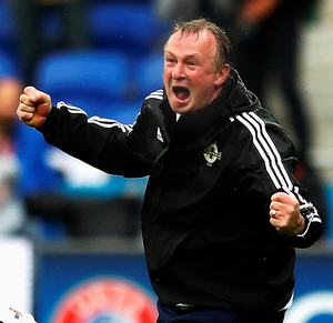 Victory roar: Michael O'Neill urges all Northern Ireland fans to get behind the team
