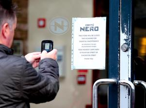 Picture -  Kevin Scott / Belfast Telegraph  Belfast - Northern Ireland - Wednesday 5th August 2015 - Caffe Nero  Members of the public photographing the sign  Pictured is the scene at Caffe Nero on the morning that the Belfast Telegraph released an exclusive video showing rats in the shop  Picture - Kevin Scott / Belfast Telegraph