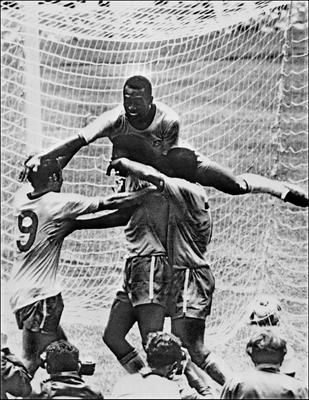 (FILES) This file photo taken on June 21, 1970 shows Brazilian forward Pele (top) celebrating with his teammates (from L) Tostao, Carlos Alberto and Jairzinho during the World Cup final between Brazil and Italy, in Mexico City.  Carlos Alberto, captain of the great Brazil team that won the 1970 World Cup, died on Tuesday of a heart attack in Rio at the age of 72, Brazil's Sportv, for whom he worked, announced.       / AFP PHOTO / STFSTF/AFP/Getty Images