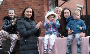 PACEMAKER, BELFAST, 2/4/2020:  Residents in the Whiterock Gardens area of Belfast applaud the NHS and key workers who are at the front line in the fight against the Coronavirus pandemic in Northern Ireland at 8pm on Thursday night. PICTURE BY STEPHEN DAVISON