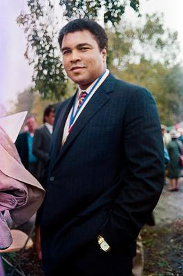 This file photo taken on October 27, 1986 shows former heavyweight world boxing champion Muhammad Ali posing in Ellis Island before 80 Ellis Island medals of honor were awarded in tribute to the USA's ethnic heritages. Boxing legend Muhammad Ali, dies at 74. The former heavyweight world champion was hospitalized on Thursday at a Phoenix, Arizona, hospital with a respiratory issue, which US media reported was complicated by his Parkinson's disease.  / AFP PHOTO / MARIA BASTONEMARIA BASTONE/AFP/Getty Images