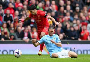 Luis Suarez of Liverpool tangles with Martin Demichelis of Manchester City during the Barclays Premier League match between Liverpool and Manchester City at Anfield on April 13, 2014 in Liverpool, England.  (Photo by Alex Livesey/Getty Images)