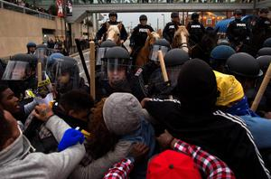 Protesters push against riot police during a rally in Baltimore, Maryland, on April 25, 2015, against the death of Freddie Gray while in police custody. Protesters targeted businesses and smashed police cars in downtown Baltimore on Saturday as the biggest demonstration yet over the death of Gray in police custody turned violent.  AFP PHOTO / ANDREW CABALLERO-REYNOLDSAndrew Caballero-Reynolds/AFP/Getty Images