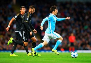 MANCHESTER, ENGLAND - SEPTEMBER 15:  David Silva of Manchester City is chased by Alvaro Morata of Juventus during the  UEFA Champions League Group D match between Manchester City FC and Juventus at the Etihad Stadium on September 15, 2015 in Manchester, United Kingdom.  (Photo by Alex Livesey/Getty Images)