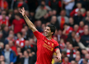Luis Suarez of Liverpool celebrates at the end of the Barclays Premier League match between Liverpool and Manchester City at Anfield on April 13, 2014 in Liverpool, England.  (Photo by Alex Livesey/Getty Images)