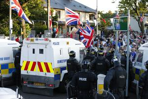Press Eye - Belfast -  Sunday 14th July 2013   Loyalists peacefully protesting in the Woodvale area of North Belfast this evening. The protest follows 2 nights of disturbances in North Belfast after police enforced a ban on an Orange Order march on Friday  The marching season in Northern Ireland is a period of events from April to August, with the highpoint on 12 July when Orangemen march to commemorate William of Orange's victory over the Catholic King James II at the Battle of the Boyne in Ireland in 1690.  Picture by Kelvin Boyes / Press Eye.