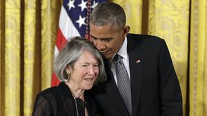 Poet Louise Gluck, who has been awarded the Nobel Prize for literature, with Barack Obama in 2015 (Carolyn Kaster/AP)