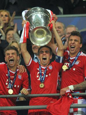 Bayern Munich's Philip Lahm lifts the UEFA Champions League trophy during the UEFA Champions League Final at Wembley Stadium, London. PRESS ASSOCIATION Photo. Picture date: Saturday May 25, 2013.