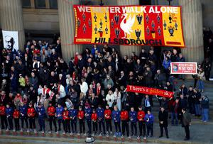 Family members of the Hillsborough victims attend a commemorative event at St George's Hall in Liverpool, to mark the outcome of the Hillsborough inquest which ruled that 96 Liverpool fans who died as a result of the Hillsborough disaster were unlawfully killed. PRESS ASSOCIATION Photo. Picture date: Wednesday April 27, 2016. See PA story INQUEST Hillsborough. Photo credit should read: Peter Byrne/PA Wire