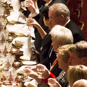 Guests, including Irish prime minister, Enda Kenny and Northern Ireland's deputy first minister Martin McGuinness, toast after a speech by Queen Elizabeth II and the President of Ireland Michael D. Higgins on April 8, 2014 in Windsor, England.