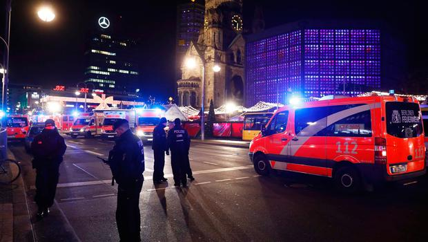 Police and ambulances are standing around the site next to the Gedächniskirche church (background) where a truck crashed into a christmas market in Berlin, on December 19, 2016 killing at least nine people and injuring at least 50 people. / AFP PHOTO / Odd ANDERSENODD ANDERSEN/AFP/Getty Images