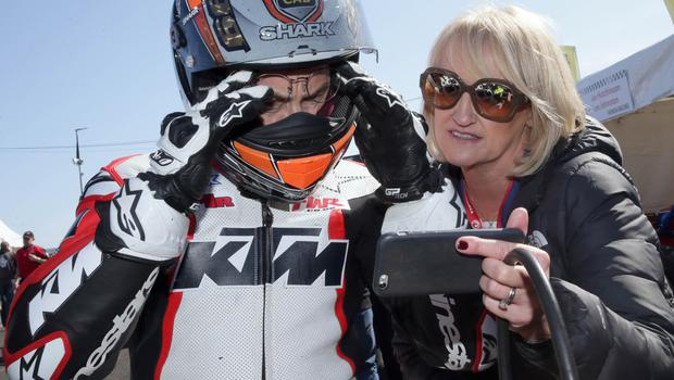 KMR Kawasaki's Jeremy McWilliams gets his lap times from his wife Jill,  on the grid during the second 2018 Vauxhall International North West 200 on Thursday. PICTURE BY STEPHEN DAVISON