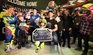 Home is the hero: Jonathan Rea greeted by young fans at Belfast City airport last night