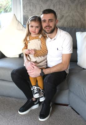Cliftonville player Conor McMenamin at home in Downpatrick with his daughter Daisy