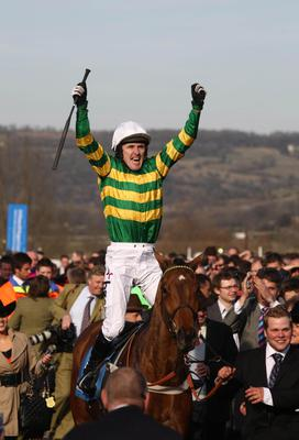 Horse Racing - Binocular Filer...File photo dated 16/03/2010 of Tony McCoy on Binocular celebrating victory in the Smurfit Kappa Champion Hurdle Challenge Trophy during day one of the 2010 Cheltenham Festival. PRESS ASSOCIATION Photo. Issue date: Sunday March 13, 2011. Nicky Henderson has been dealt a hammer blow with the news that Binocular will miss Tuesday's stanjames.com Champion Hurdle at Cheltenham. See PA story RACING Binocular. Photo credit should read: David Davies/PA Wire. ...S