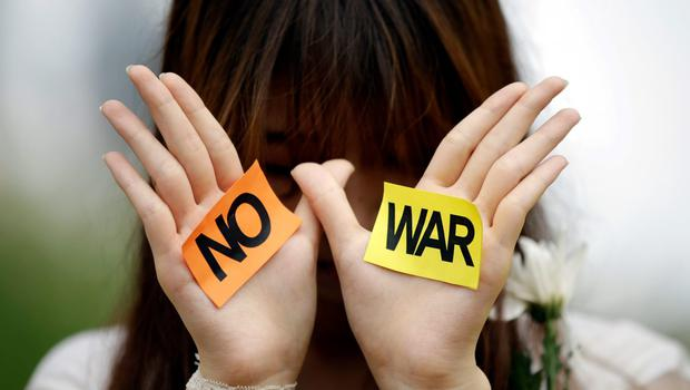 A South Korean student displays a message during a rally against the Israeli military operations in Gaza and the West Bank and wishes for peace near the Israeli Embassy in Seoul, South Korea, Wednesday, July 30, 2014. (AP Photo/Lee Jin-man)