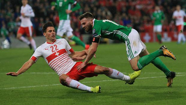 Pacemaker Belfast 9-11-17 Northern Ireland v Switzerland - World Cup Play-off Northern Ireland's Stuart Dallas and Switzerland's Fabian Schar during this evenings game at the National Stadium, Belfast.  Photo by David Maginnis/Pacemaker Press
