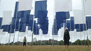 Angela Helleur (right), chief nurse of Lewisham and Greenwich NHS Trust, and Chloe Heard, from Greenwich and Docklands Festival, pose next to Luke Jerram's In Memoriam art installation outside the Queen Elizabeth Hospital on Woolwich Common, London (Yui Mok/PA)