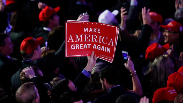 "NEW YORK, NY - NOVEMBER 08:  An attendee holds up a sign in support of Republican presidential nominee Donald Trump that reads ""Make America Great Again"" during the election night event at the New York Hilton Midtown on November 8, 2016 in New York City. Americans today will choose between Republican presidential nominee Donald Trump and Democratic presidential nominee Hillary Clinton as they go to the polls to vote for the next president of the United States.  (Photo by Joe Raedle/Getty Images)"