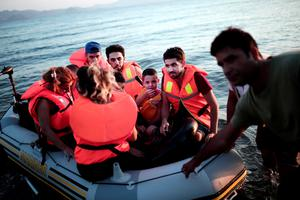 "Migrants arrive on a beach on the Greek island of Kos, after crossing a part of the Aegean Sea between Turkey and Greece in an inflatable raft, on August 12, 2015. The number of migrants and refugees arriving on Greece's shores has exploded this year, but the Mediterranean country provides virtually no reception facilities and leaves them wallowing in ""totally shameful"" conditions, a UN official said on August 7.  The UN refugee agency's division for Europe said 124,000 refugees and migrants have landed in Greece since the beginning of the year.  AFP PHOTO / ANGELOS TZORTZINISANGELOS TZORTZINIS/AFP/Getty Images"
