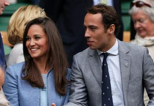LONDON, ENGLAND - JUNE 24:  James Middleton shakes hands with Condoleezza Rice next to Pippa Middleton during the Gentlemen's Singles first round match between Andy Murray of Great Britain and Benjamin Becker of Germany on day one of the Wimbledon Lawn Tennis Championships at the All England Lawn Tennis and Croquet Club on June 24, 2013 in London, England.  (Photo by Clive Brunskill/Getty Images)