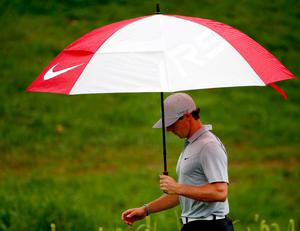 LOUISVILLE, KY - AUGUST 08: Rory McIlroy of Northern Ireland walks off the 15th tee under an umbrella during the second round of the 96th PGA Championship at Valhalla Golf Club on August 8, 2014 in Louisville, Kentucky.  (Photo by Sam Greenwood/Getty Images)