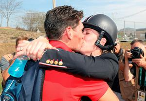 Great Britain's Charlotte Dujardin with her fiancé Dean Wyatt Golding (right) following her gold medal in the dressage individual grand prix freestyle on the tenth day of the Rio Olympics Games, Brazil. PRESS ASSOCIATION Photo. Picture date: Monday August 15, 2016. Photo credit should read: David Davies/PA Wire. EDITORIAL USE ONLY