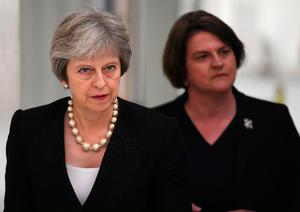 Prime Minister Theresa May (left) and Arlene Foster, the leader of the Democratic Unionist Party (DUP). Pic: Clodagh Kilcoyne/PA Wire