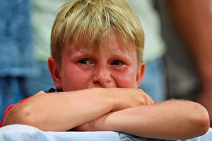 A young England fans reacts after England lost 2-1 to Iceland in the Euro 2016 round of 16 football match between England and Iceland at the Allianz Riviera stadium in Nice on June 27, 2016.   / AFP PHOTO / PAUL ELLISPAUL ELLIS/AFP/Getty Images