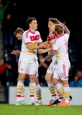 Scotland's Christophe Berra celebrates his goal with Scotland's Johnny Russell and Scotland's Craig Forsyth during the International Friendly at Hampden Park, Glasgow. PRESS ASSOCIATION Photo. Picture date: Wednesday March 25, 2015. See PA story SOCCER Scotland. Photo credit should read: Richard Sellers/PA Wire. RESTRICTIONS: Use subject to restrictions. Editorial use only. Commercial use only with prior written consent of the Scottish FA. Call +44 (0)1158 447447 for further information.