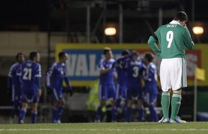 Northern Ireland's David Healy as Israel celebrate scoring during Tuesday night's World Cup qualifier at Windsor Park, Belfast
