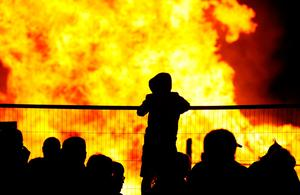 People attend an 11th night Bonfire in the Sandy Row area of Belfast, as hundreds of bonfires were set to be lit at midnight, as part of a loyalist tradition to mark the anniversary of the Protestant King William's victory over the Catholic King James at the Battle of the Boyne in 1690. PRESS ASSOCIATION Photo. Picture date: Friday July 12, 2019. See PA story ULSTER Bonfires. Photo credit should read: Brian Lawless/PA Wire