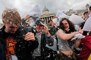 Revellers take part in a giant pillow fight in Trafalgar Square on 'International Pillow Fight Day' on April 4, 2015 in London, England. Pillow fights have been organised in numerous other cities around the world simultaneously.  (Photo by Dan Kitwood/Getty Images)