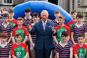 The Prince of Wales with pupils from St Patrick's Grammar School, Armagh and The Royal School, Armagh, during an engagement at Palace Demense in Co. Armagh. PRESS ASSOCIATION Photo. Picture date: Wednesday May 22, 2019. See PA story ROYAL Tour. Photo credit should read: Liam McBurney/PA Wire