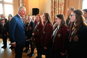The Prince of Wales meeting the choir during his visit to Brownlow House, Lugan, on the second day of his tour of Northern Ireland.  PRESS ASSOCIATION Photo. Picture date: Wednesday May 22, 2019. See PA story ROYAL Tour. Photo credit should read: Owen Humphreys/PA Wire