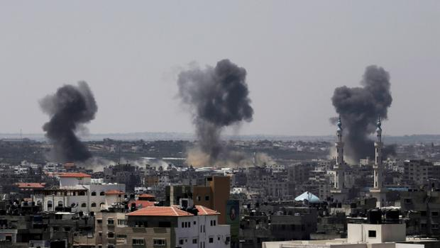 Smoke rises after Israeli missile strikes hit the northern Gaza Strip, Wednesday, July 16, 2014. (AP Photo/Adel Hana)