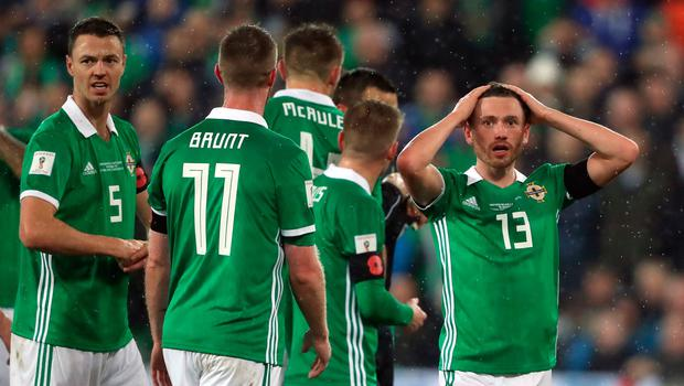 Northern Ireland's Corry Evans (right) reacts after conceding a penalty for handball during the 2018 World Cup Qualifying Play-Off, First Leg match at Windsor Park, Belfast. PRESS ASSOCIATION Photo. Picture date: Thursday November 9, 2017. Niall Carson/PA Wire.