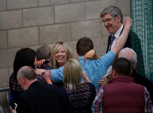 Catherine Seeley and John O'Dowd of Sinn Fein celebrate their re-election as counting of votes continues at Banbridge Leisure centre for Upper Bann constituency in the Northern Ireland Assembly Elections.  Niall Carson/PA Wire
